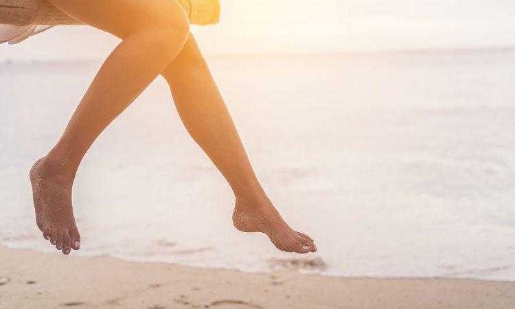 Image of legs on the beach