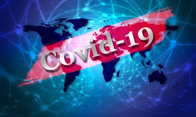 Covid-19 avec map du monde en arrière-plan.